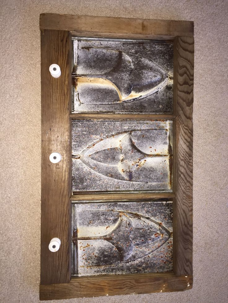 Made from old barn window and tin ceiling tiles with electric fence insulators for pegs. & 34 best Antique Addiction images on Pinterest | Addiction Merry ...