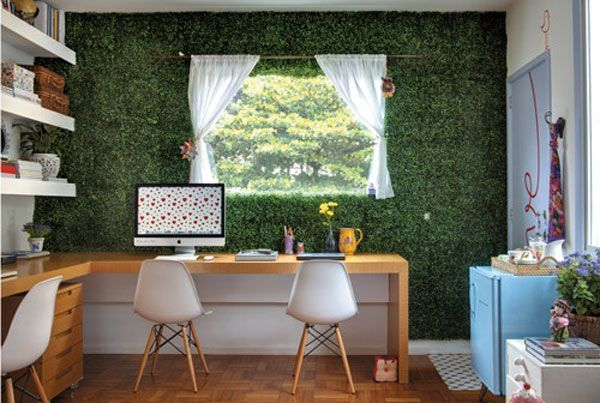 Image of a room with artificial grass as a wall covering on one wall