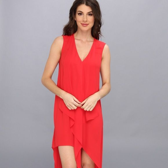 BCBG Maxazria high low dress. Make an entrance with this BCBG high low dress in lipstick red. Only worn twice. Can be worn with leggings also. For sizing estimate, I am 5'2 and weight 120lbs, bra size 34 B. I don't think it would fit anyone with a bigger bra size. 100% polyester. BCBGMaxAzria Dresses High Low