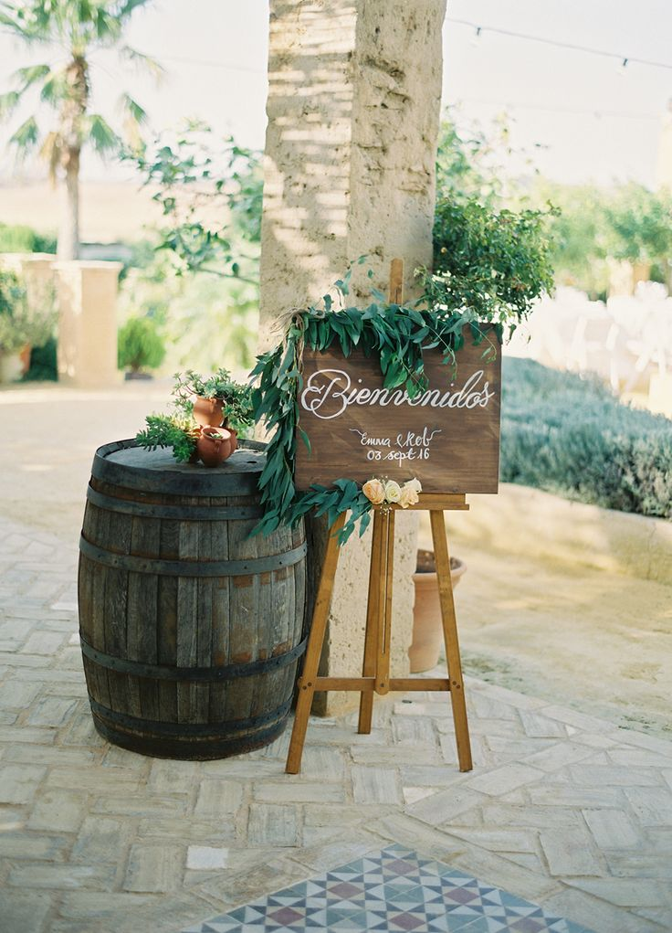 wedding welcome sign - photo by Romance Weddings by Joseba Sandoval Photography http://ruffledblog.com/this-cheerful-spanish-wedding-brings-the-romance