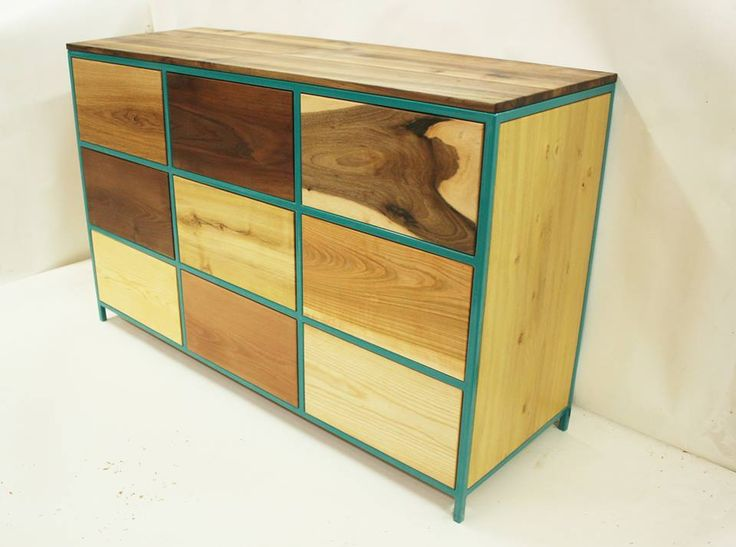 This commode was made of 9 tree races with metal frame. You can change the tree races and the colour of frame and open the drawers by weak pressure. Size  Width: 146 cm Depth: 92 cm Altitude: 50 cm You can be ordered with 12 drawers.