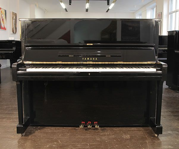 A 1975, Yamaha U1 upright piano with a black case and polyester finish at Besbrode Pianos. Piano has an eighty-eight note keyboard and three pedals £2750