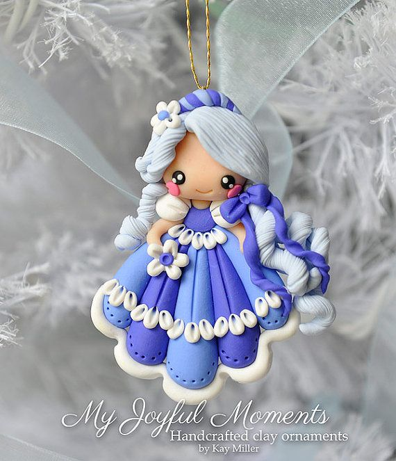 This is s one of a kind, handcrafted sweet little angel ornament made of durable polymer clay, with much attention given to detail and careful