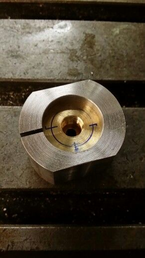 Now we have a split bushing clamp!  The brass discs are placed inside (already a tight fit) and then clamped in the vice