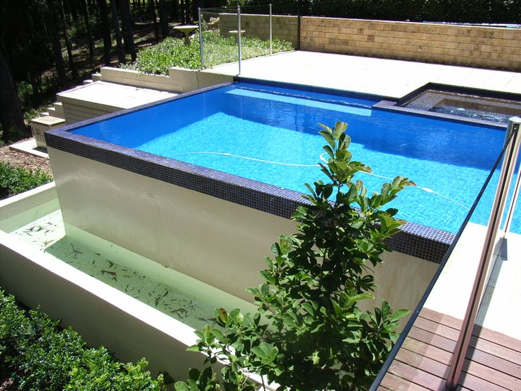 Negative edge pool with overflow tank pool l design for Pool edges design