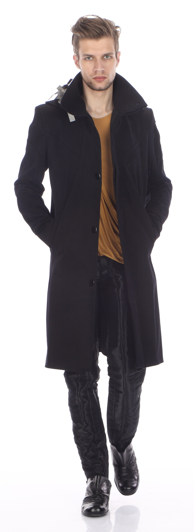 Coat ( cotton), top ( silk jersey), trousers (polyester), shoes ( leather)