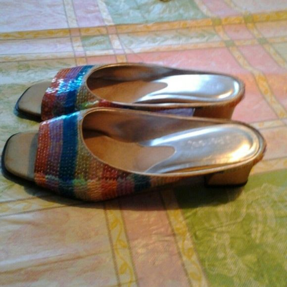 Sequined shoes reduced for quick sale. Only worn once they are just beautiful rainbow sequin shoes.Low heel comfortable great for all occasions On the shoe they say nine but they must run small because I wear an 81/2 Shoes