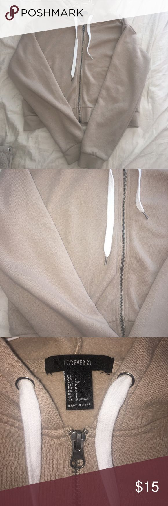 Beige Cropped Hoodie Cropped hoodie from forever 21. Worn couple times but in good condition. Super comfy. Size Woman's Small. Sight pilling under the sleeves (shown in last pic) but other than that in great condition Forever 21 Tops Sweatshirts & Hoodies