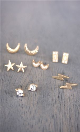 Moon Child Earring Set - Gold This earrings set is great if your looking to outfit multiple piercings on one ear.  Layering these gold star, moon, lightning blot studs are simple.  Start from your earlobe with the biggest stud and work your way up to your cartilage with the smallest!