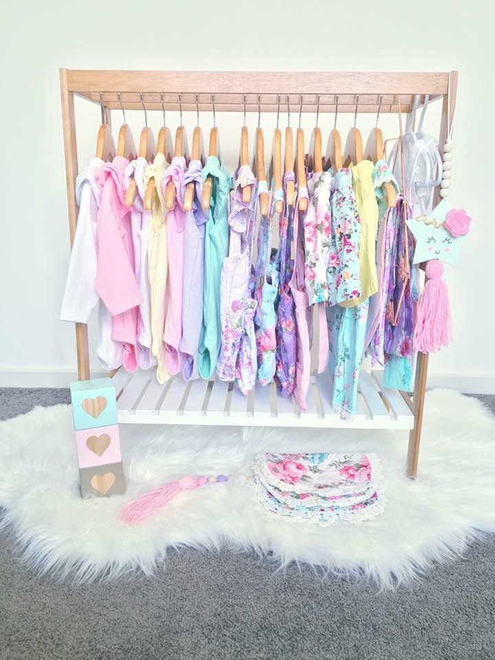 Mini clothes rack- Kmart Bamboo towel rail + wooden hangers + fur rug