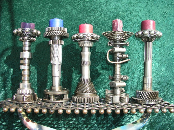 Pretty cool candlesticks from engineered scrap metal for Cool candlesticks