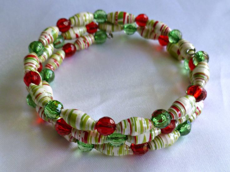 Holiday colored green and red paper bead bracelet on memory wire, boho jewelry, recycled/upcycled bracelet by TheBeckoningCat on Etsy