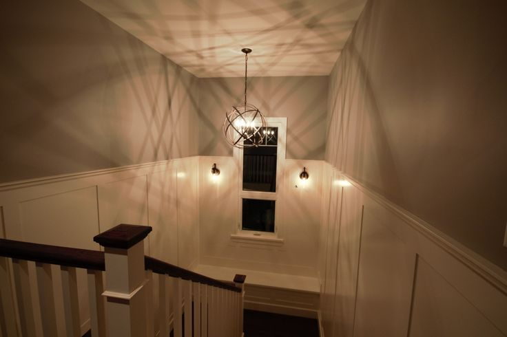staircase with wainscoting and bench seat