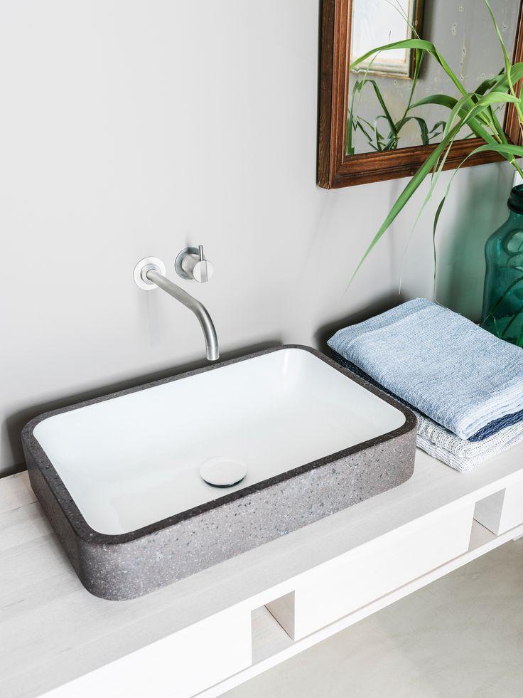 Sink in lavastone, white glazed inside.