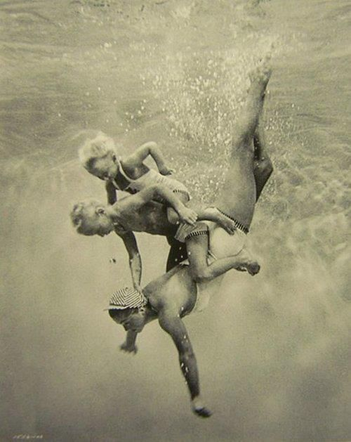 mother and children diving