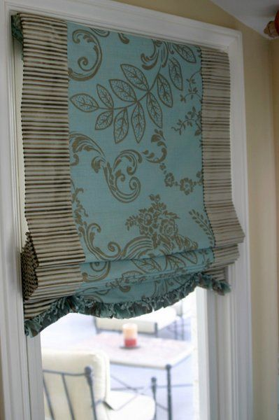 Lou Lou's custom roman blind for client in Arizona.  Created using two fabrics and a beautiful trim.  Butterfly styled roman blind.