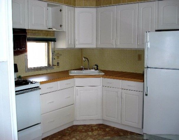 Michael biondo 39 s single wide mobile home remodel home white kitchen cabinets and white kitchens Mobile home kitchen remodel pictures