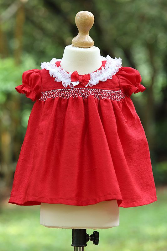Smocked Lace Trimmed Collar Dress   2 coloured hand smocked dupiol faux silk dress with laced trims on the edge of the collar. Matching panties are available