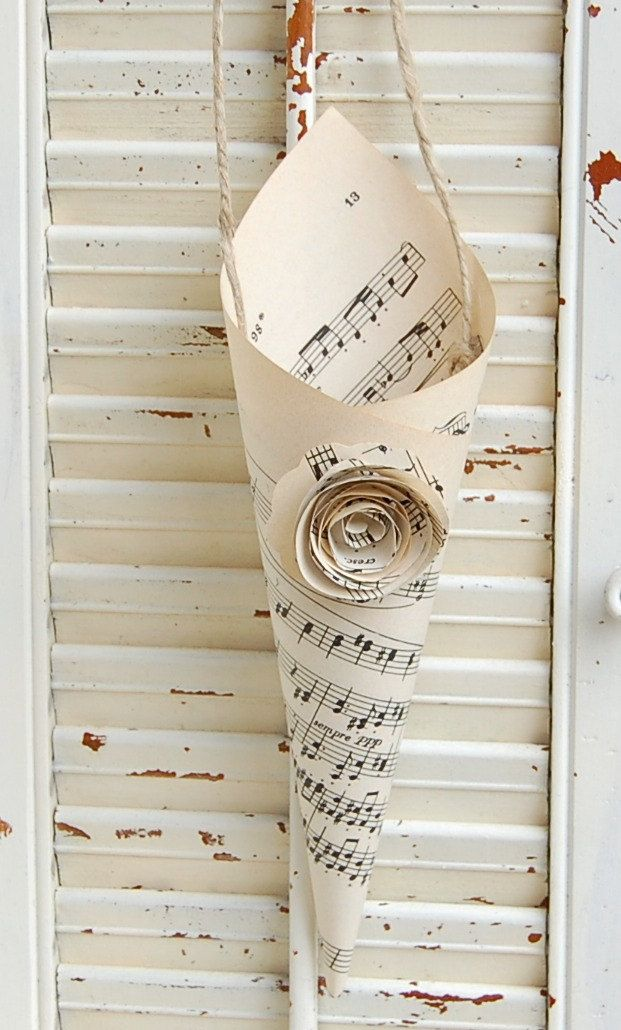 Wedding confetti cones with a vintage feel - handmade out of old sheets of music - what a lovely thing to make with friend over a glass (or two)
