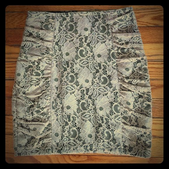 Topshop lace skirt  TOPSHOP beautiful lace skirt with ruching. Flattering beige color and fitted shape will make this a great addition to your wardrobe. Double lined on inside with black Lycra material. Worn once. S/F and P/F home. Think about holiday gatherings! Topshop Skirts