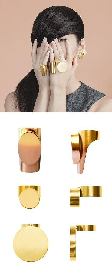 "When the world is flat, you stand out. I like these chunky gold-plated rings from ""The World is Flat"" by j0o0lry (Stockholm-based Hyunjung Cho); of particular note is the gold/rosegold ombré on that long piece."