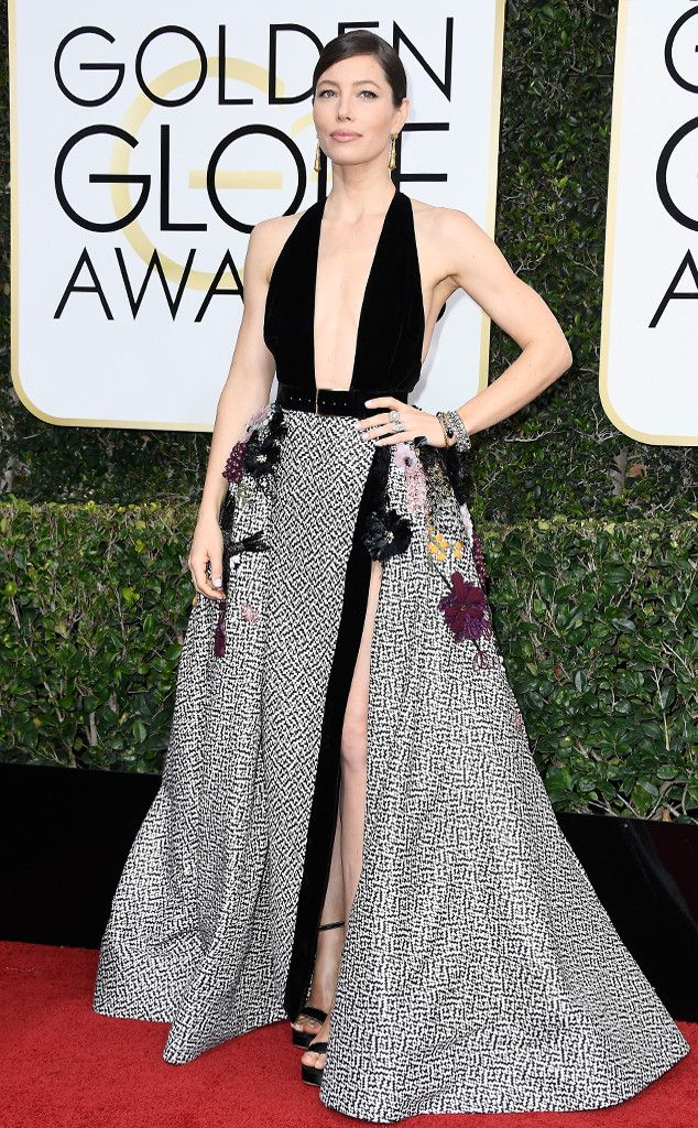 2017 Golden Globes: Jessica Biel is wearing an Elie Saab gown with a plunging neckline, black/white design, and 3D floral appliques. I like the velvet bodice. This gown is fun, unique, and is very modern!