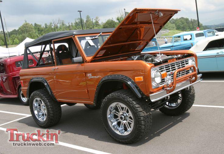 classic orange Ford Bronco hood open