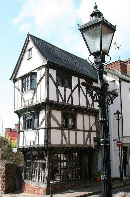 """Exeter, West Gate, The House that Moved Photo by Tollhouse Alan """" The House that Moved, Exeter, Devon, England. This 14th century house was moved all because archaeologists couldn't bear to part with it, but the city needed to run a road right..."""