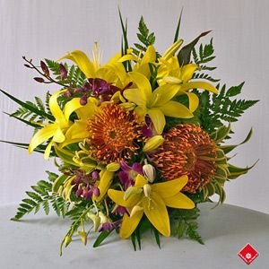 Tropical Bouquet featuring Lily, Protea and Dendrobium orchid