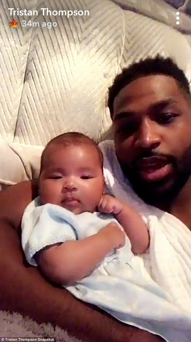 e679722492cbb Family time: Tristan Thompson cuddled up to his baby girl in a sweet video  shared to Snapchat on Tuesday afternoon