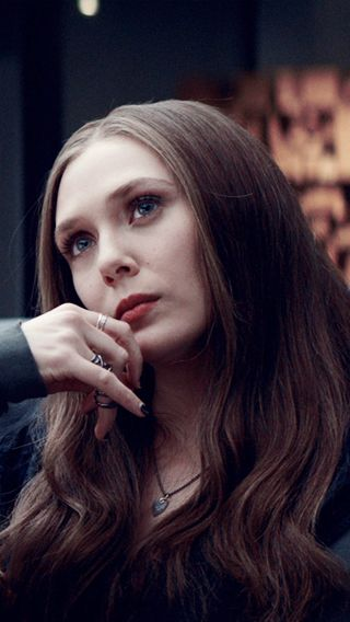 I love her soft brown hair with blue eyes. So pretty!