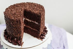 boston blackout cake; a rich devil's food cake, a layer of a homemade eggless chocolate pudding filling, a homemade eggless vanilla pudding layer, and covered in a dark chocolate ganache buttercream