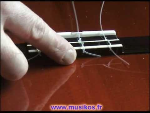 """Pour plus de détails, voir ma vidéo """"Changer cordes Guitare classique par Jean-Noel Bret"""" ou retrouvez moi sur http://jnbcours.perso.neuf.fr"""