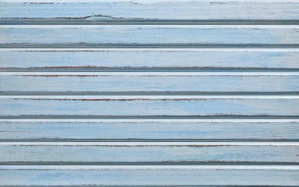 fundo de madeira desgastada pintada de azul