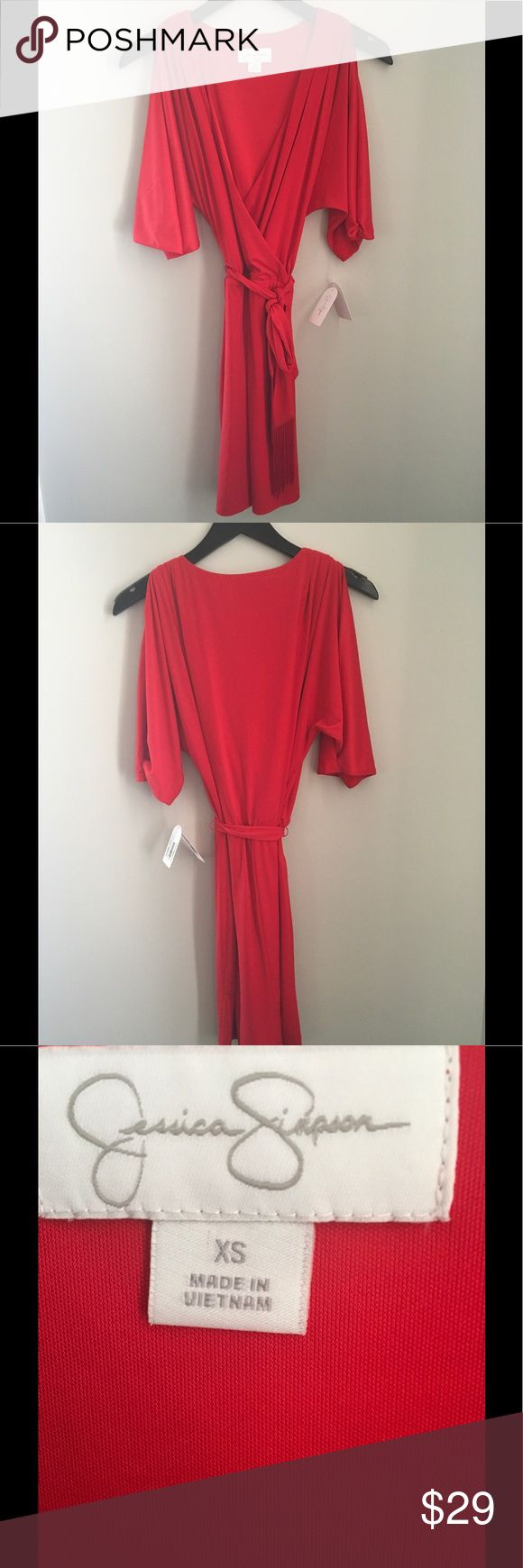 Jessica Simpson red wrap dress And this great wrap dress by Jessica Simpson! This dress has the cut out shoulders that are hot this season! This dress is finished off with the tie with fringe!! Is an extra small and fits like a 2 or 4. Jessica Simpson Dresses