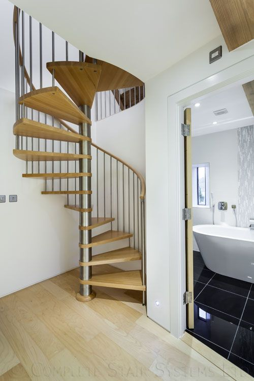 Spiral Staircase supplied to a customer in Gloucester with beech treads and a handrail in one piece.