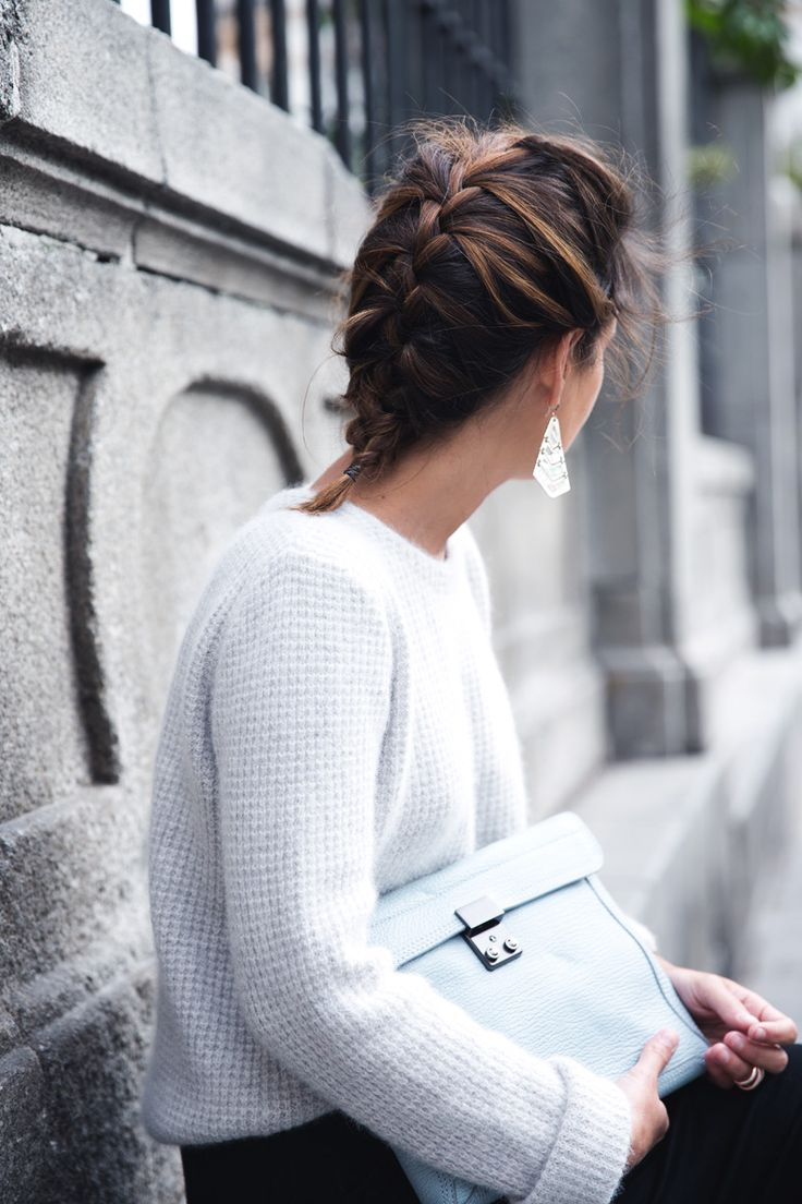 Love the combination of the white sweater, pastel blue clutch, & silver earrings. Also the french braid!