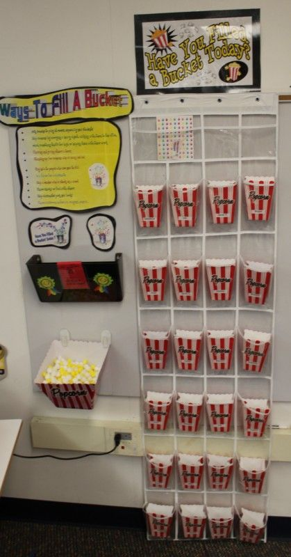 Popcorn cups (from Target dollar bins) in shoe storage to hold all kinds of things!
