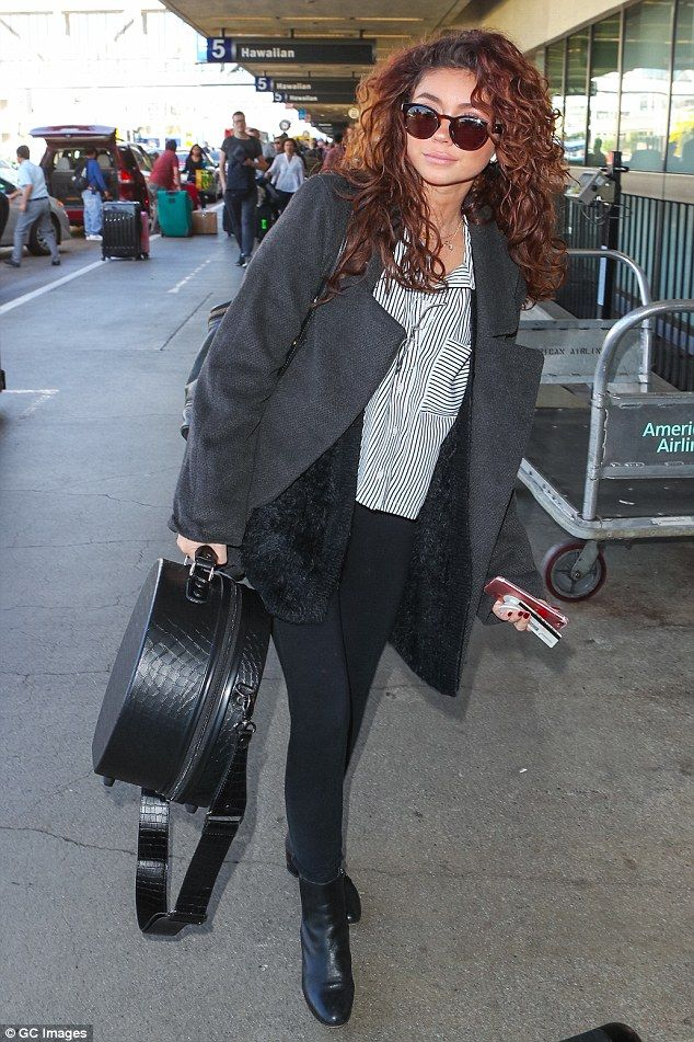 Flying high on love: Sarah Hyland was flying solo as she arrived at Los Angeles International Airport without her Bachelorette star beau Wells Adams on Thursday