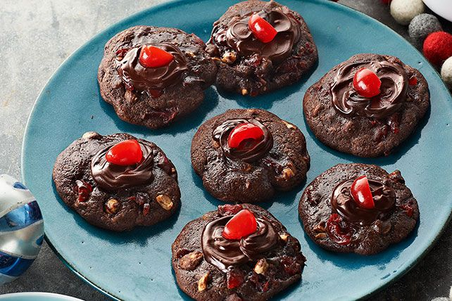 These Cherry-Chocolate Volcano Cookies feature a buttery mix of chocolate and maraschino cherry liquid where the lava would normally be.