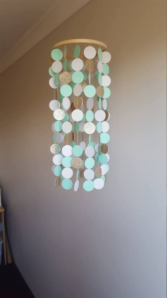 Check out this item in my Etsy shop https://www.etsy.com/au/listing/520840437/mint-and-gold-baby-mobile-paper-mobile