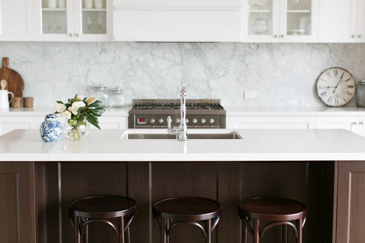 Hampton style kitchen with marble splash back, contrast dark island bench and bentwood stools