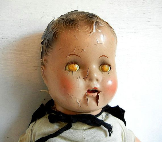 Creepy Doll With Teeth And Dead Yellow Eyes