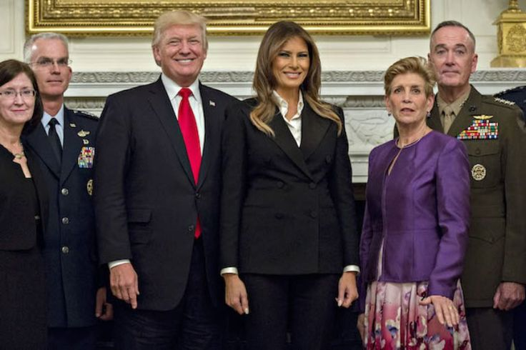 WASHINGTON, DC - OCTOBER 5: U.S. President Donald Trump and first lady Melania Trump pose for pictures with senior military leaders and spouses, including including Gen. Joseph Dunford (R), chairman of the joint chiefs of staff, and General Paul Selva (2nd L), vice chairman of the joint chiefs of staff, after a briefing in the State Dining Room of the White House October 5, 2017 in Washington, D.C. The Trumps are hosting the group for a dinner in the Blue Room. (Photo by Andrew…