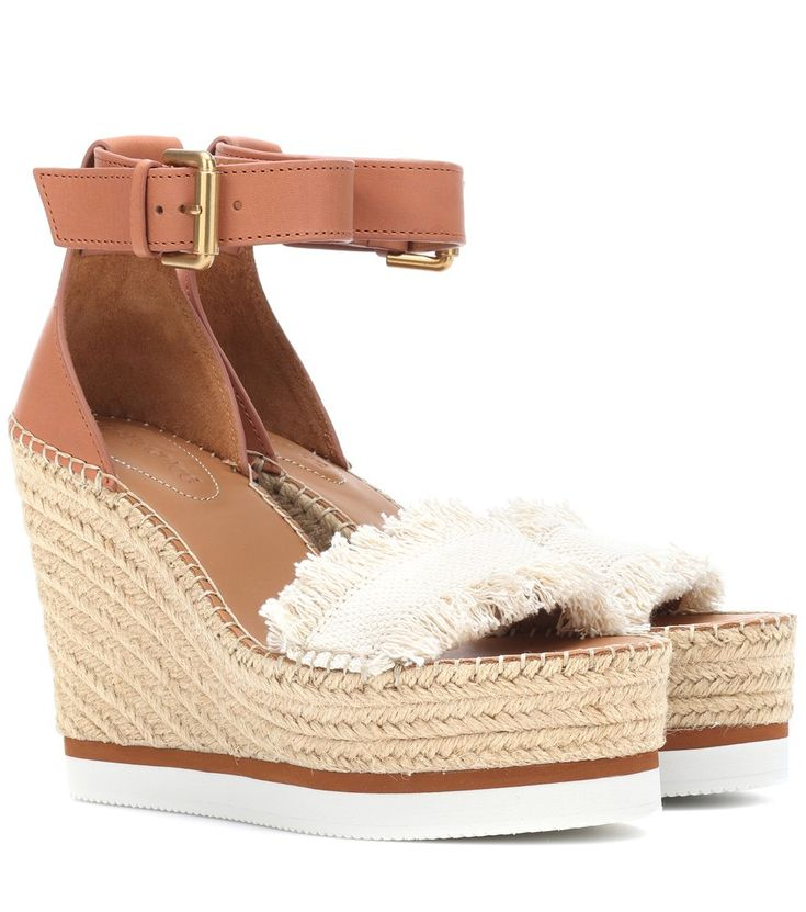 See By Chloé - Leather and canvas wedge sandals - See By Chloé's sandals channel a warm-weather vibe with their espadrille-like wedge platform. A brown leather ankle strap and heel counter add support, while a canvas toe strap with frayed edges brings tactile edge. Team yours with shorts and skirts on your next vacation. seen @ www.mytheresa.com