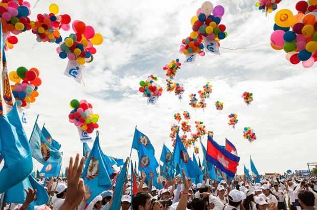 Supporters release balloons during a pre-election rally for the ruling Cambodian People's Party in Phnom Penh, Cambodia.