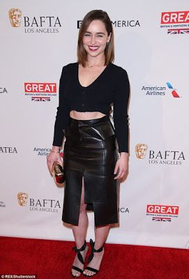 "Emilia Clarke bares her abs at BAFTA tea party   Emilia Clarke bared her impressively-toned abs in a flirty leather pencil skirt at the Four Seasons in Beverly Hills Saturday.  Stylist Kate Young dressed the 29-year-old actress in a long-sleeved black crop-top matching stilettos and gold clutch for the BAFTA tea party.  The taut two-time Emmy nominee relies on author James Duigan's Clean and Lean diet to maintain her svelte 5""2' figure.  Clarke enjoyed a mini-Game of Thrones reunion with…"