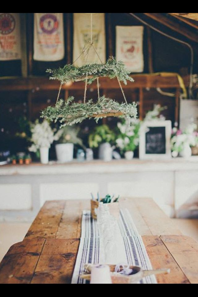 """A simple greenery and twine """"chandelier"""" via kinfolk magazine. Would make a simple, modern holiday table."""