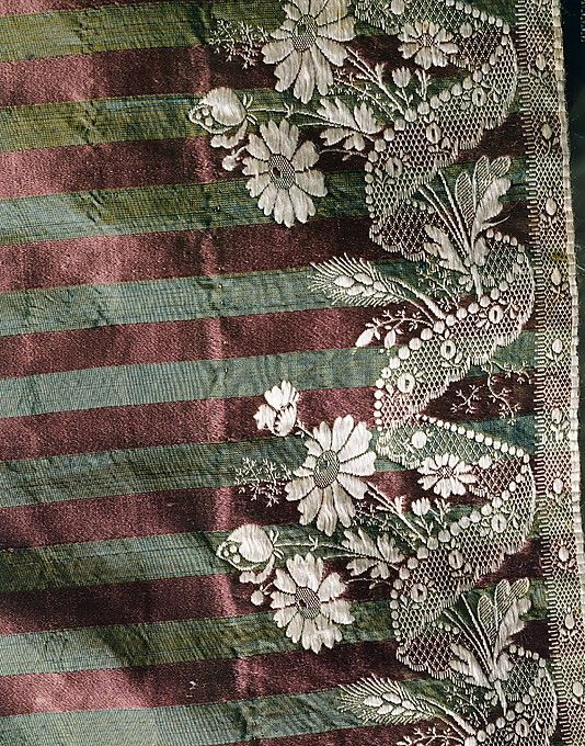 From the hem of a 1795 round gown, the MET.
