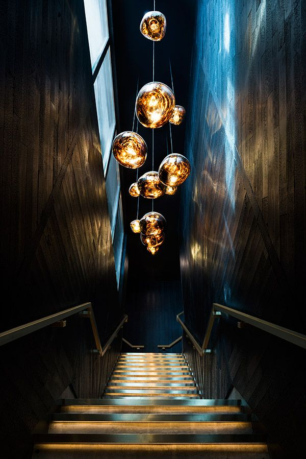 MELT pendants light the stairs at Alto Bar and Restaurant, Hong Kong. Melt is a distorted lighting globe born from our collaboration with Swedish radical design collective FRONT. The light bouncing and reflecting around the uneven surfaces creates a dramatic melting hot blown glass effect. MELT is translucent when on and mirror finish when off. Its internal luminosity is visible in full daylight.